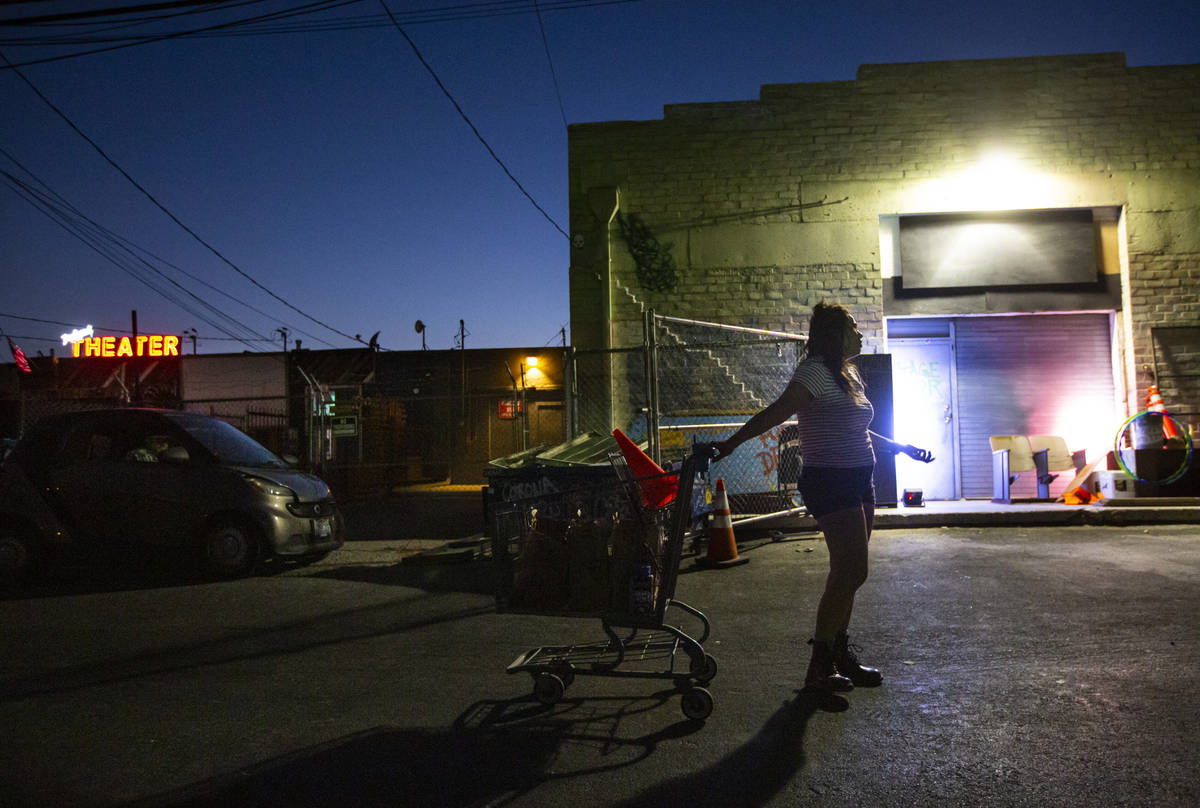 """J, played by Natalie Senecal, performs during a rehearsal of """"The Parking Lot"""" outsid ..."""