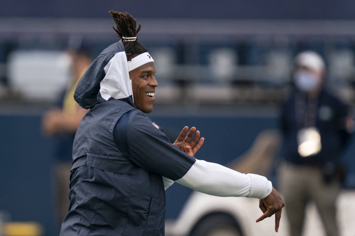 New England Patriots quarterback Cam Newton warms up before an NFL football game against the Se ...