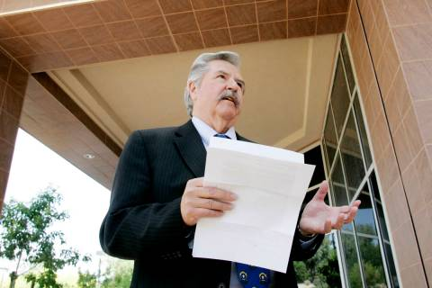 Former Las Vegas Review-Journal editor Thomas Mitchell holds a press conference outside the Gra ...