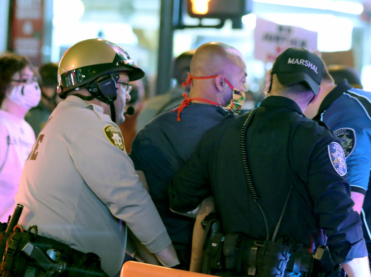 Las Vegas defense attorney Jonathan MacArthur is arrested during a demonstration in honor of Br ...