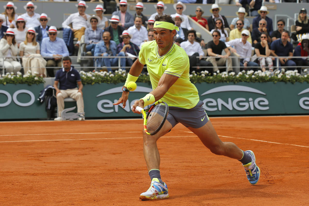 Spain's Rafael Nadal plays a shot against Austria's Dominic Thiem during the men's final match ...