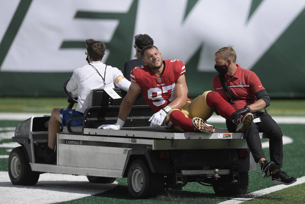 San Francisco 49ers defensive end Nick Bosa (97) is driven off the field after being injured du ...