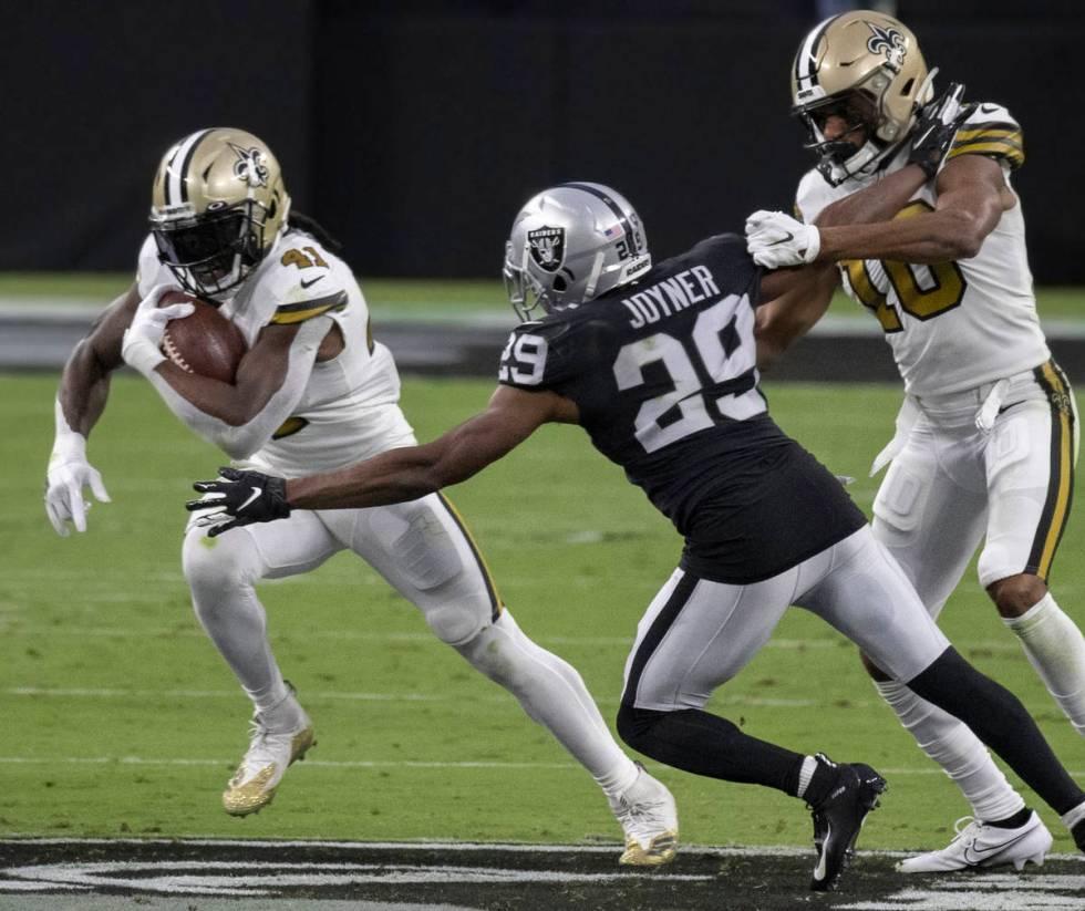 New Orleans Saints running back Alvin Kamara (41) cuts up field past Las Vegas Raiders free saf ...