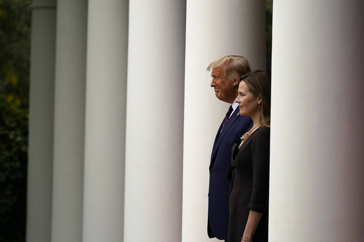 President Donald Trump walks with Judge Amy Coney Barrett to a news conference to announce Barr ...