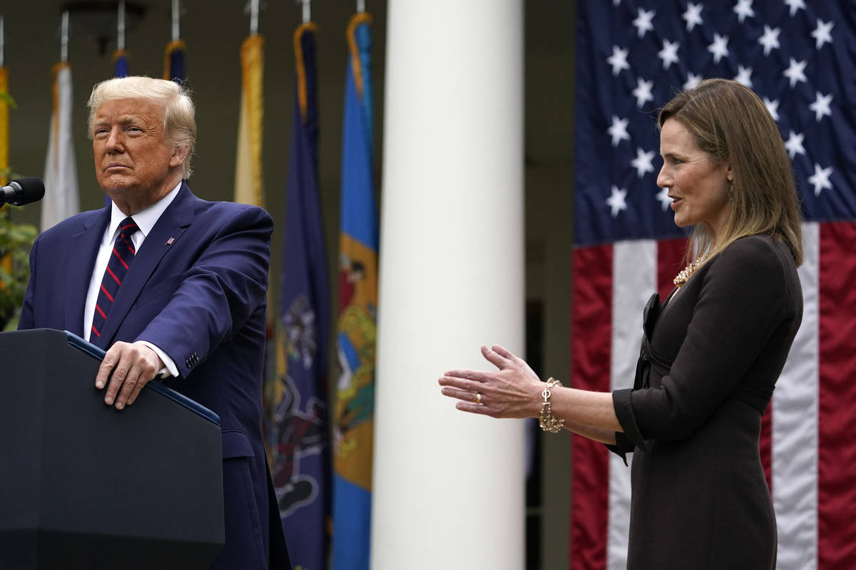 Judge Amy Coney Barrett applauds as President Donald Trump announces Barrett as his nominee to ...