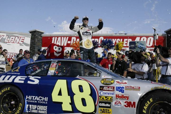 Jimmie Johnson celebrates his win in victory lane after the Nextel Cup Series at the Las Vegas ...