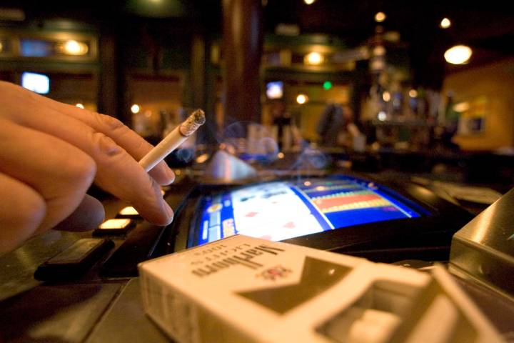 A smoker at a video poker machine in Las Vegas. (K.M. Cannon/Las Vegas Review-Journal)