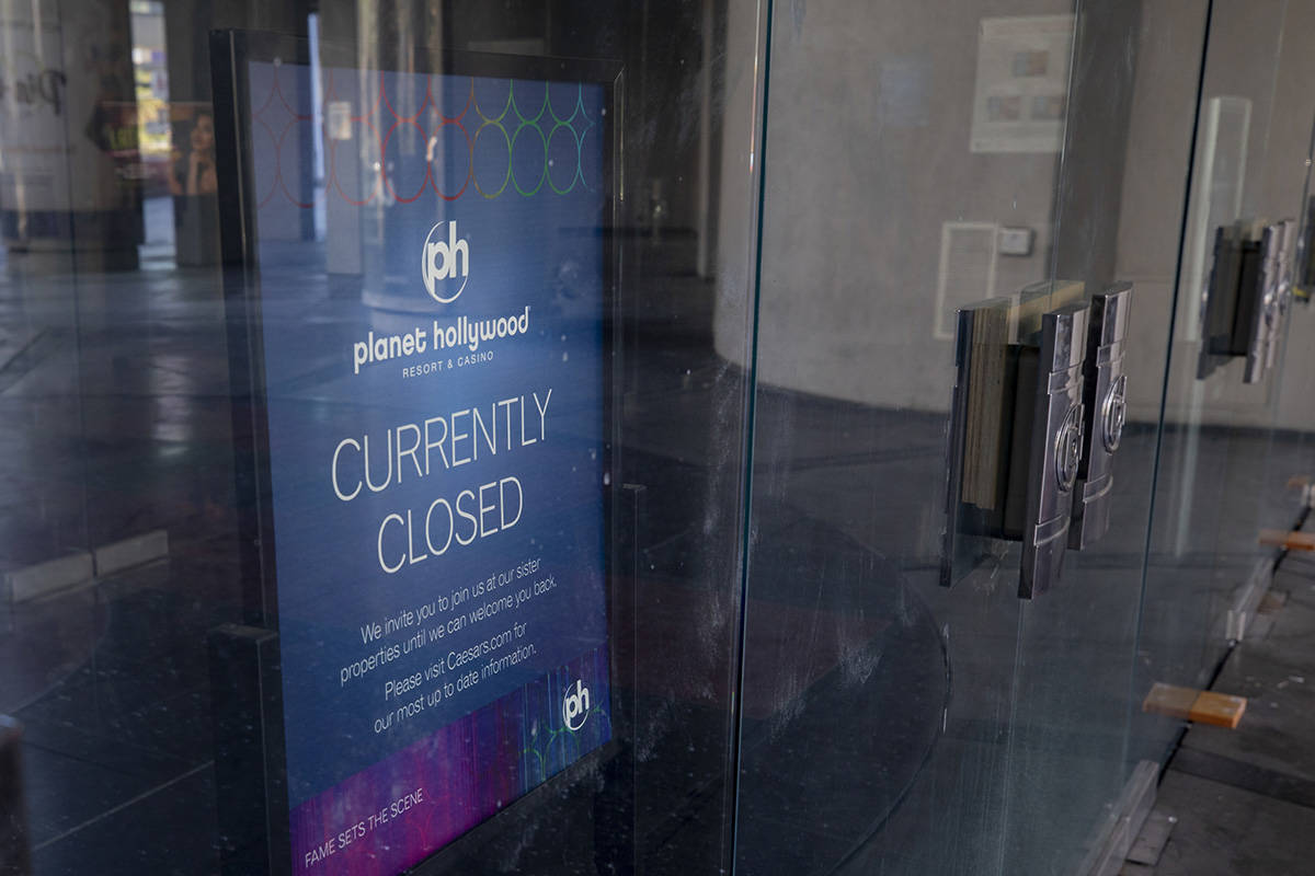 A sign stating Planet HollywoodÕs temporary closure is seen inside the doors of the hotel- ...