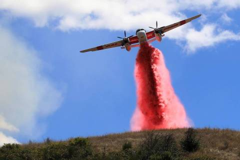 Cal Fire air tankers help stop the spread of a brush fire in Larkfield Calif, Thursday, Sept. 2 ...