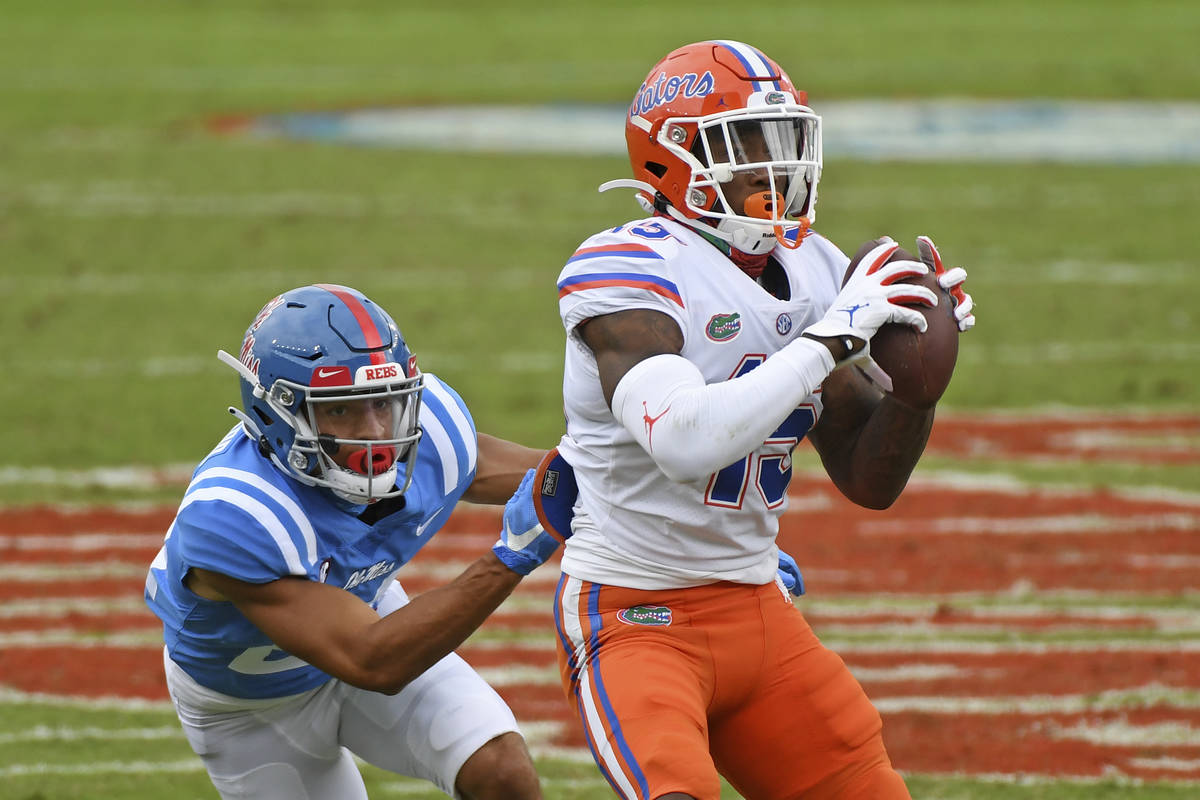 Florida wide receiver Jacob Copeland (15) catches a pass as Mississippi defensive back Deane Le ...