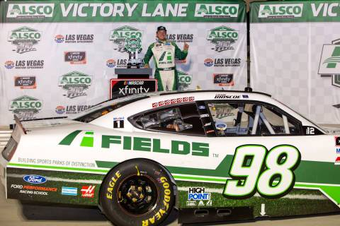 Alsco 300 race winner Chase Briscoe (98) poses in victory lane during the NASCAR Xfinity Series ...