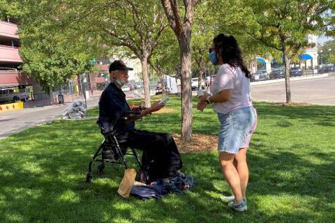 A volunteer with the Reno Burrito Project handing out free burritos at City Plaza in downtown R ...