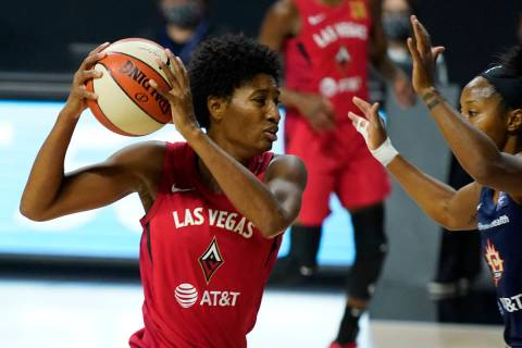 Las Vegas Aces forward Angel McCoughtry (35) drives against Connecticut Sun guard Briann Januar ...