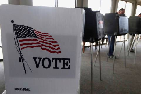 FILE - In this March 18, 2014 file photo, voters cast their ballots in Hinsdale, Ill. Illinois ...