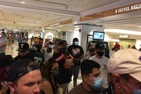 Visitors wait in a line during a lockdown at the Flamingo on Monday, Sept. 28, 2020. (Andrew Sc ...