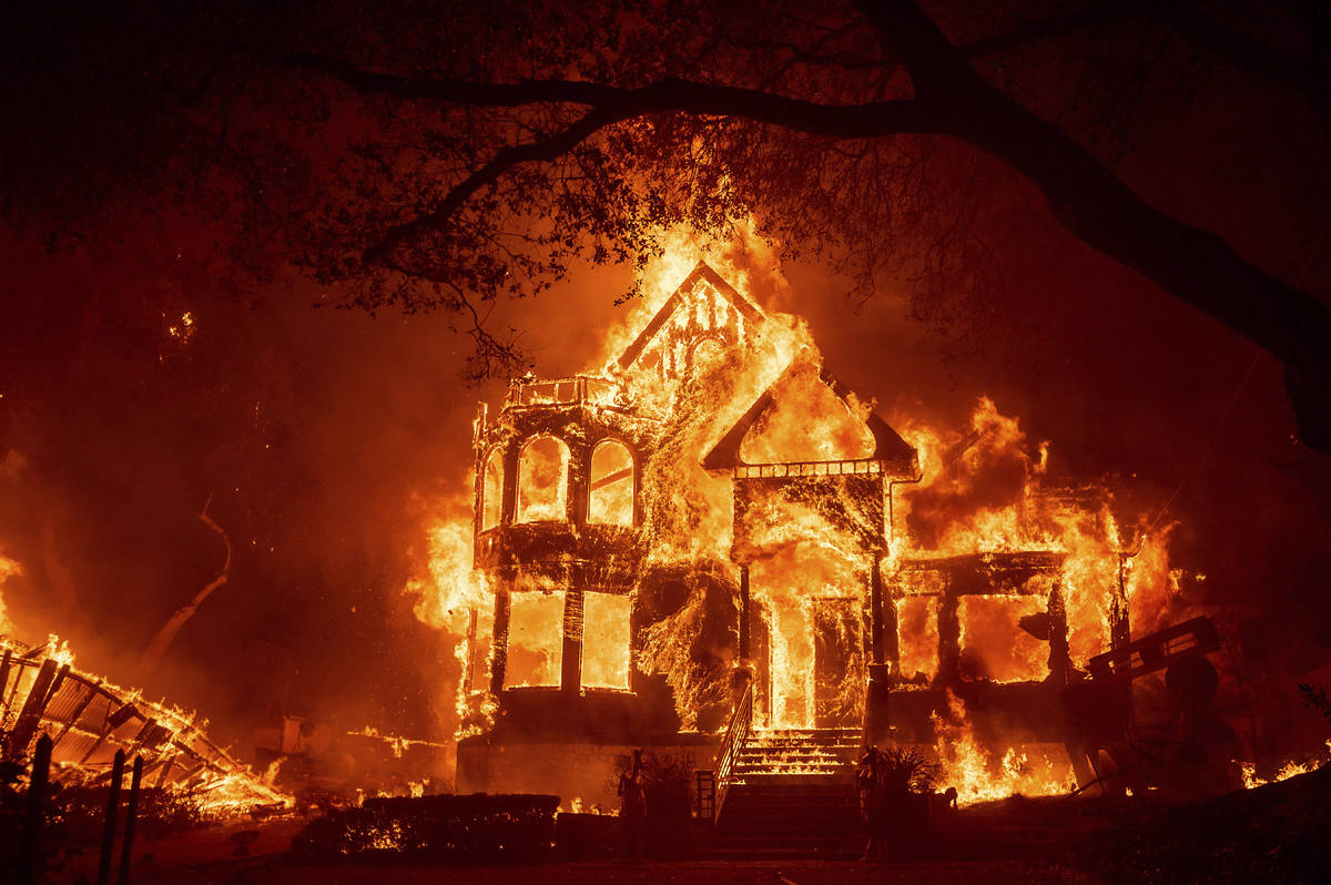 Flames from the Glass Fire consume the Glass Mountain Inn, late Sunday, Sept. 27, 2020, in St. ...