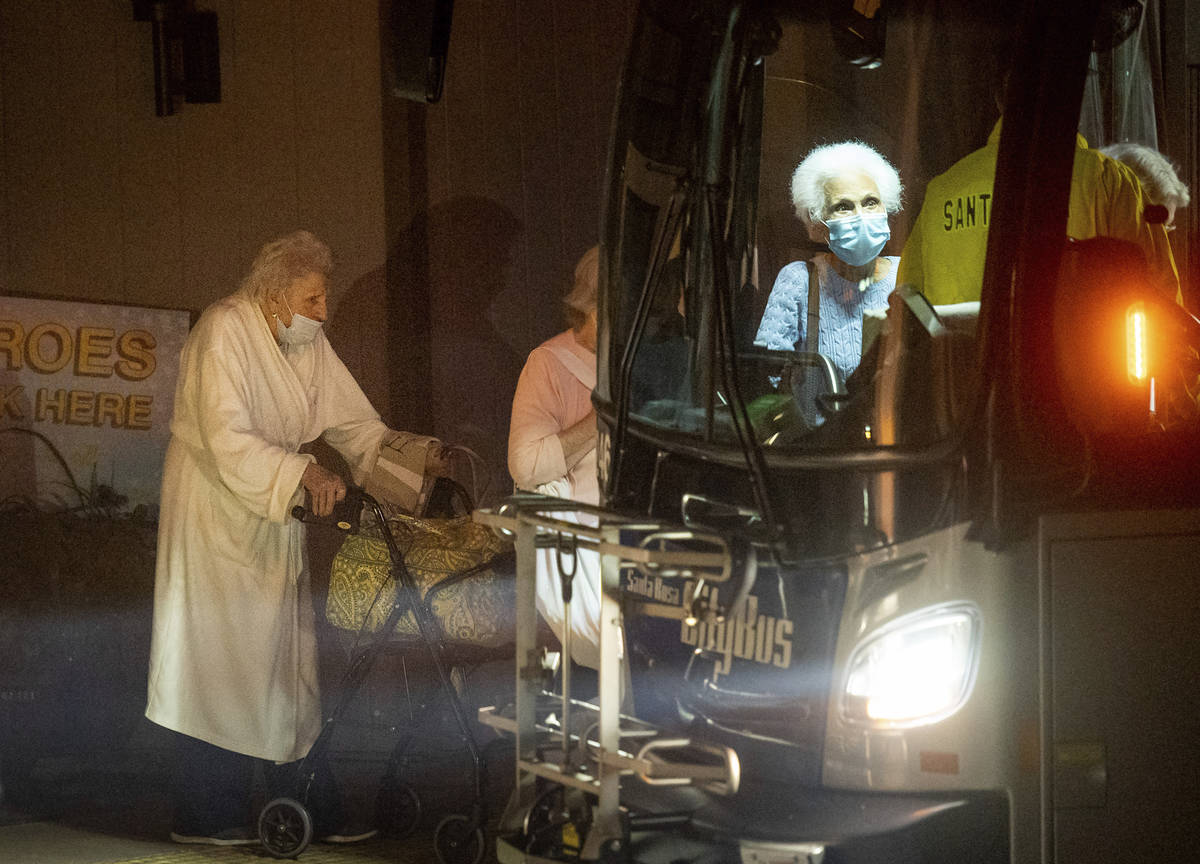 Residents of the Oakmont Gardens senior home evacuate by bus as the Shady Fire approaches Santa ...