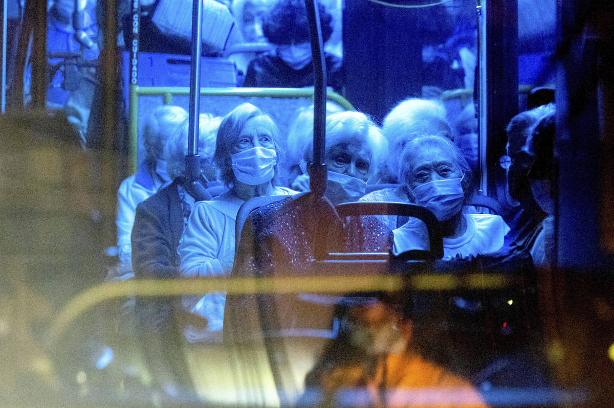 Residents of the Oakmont Gardens senior home evacuate as the Shady Fire approaches in Santa Ros ...