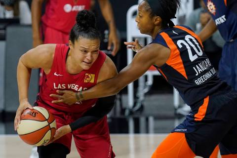 Connecticut Sun guard Briann January (20) fouls Las Vegas Aces guard Kayla McBride (21) during ...