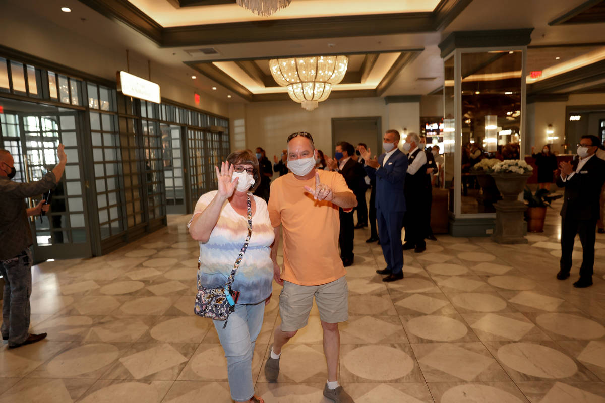Matt and Donna Daniels of Midlothian, Ill. are among the first customers through the doors as P ...