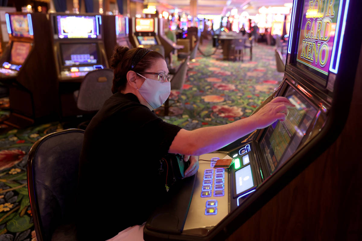 Sue Panici of Muskegon, Mich. plays a machine as Park MGM reopens after the coronavirus shutdow ...
