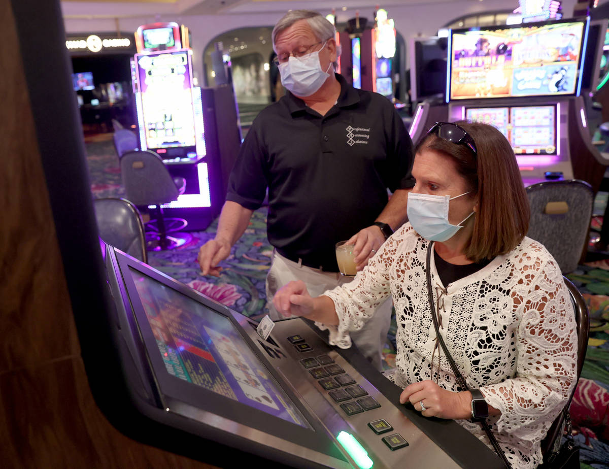 Sharon and Don Jones of Muskegon, Mich. play a machine as Park MGM reopens after the coronaviru ...