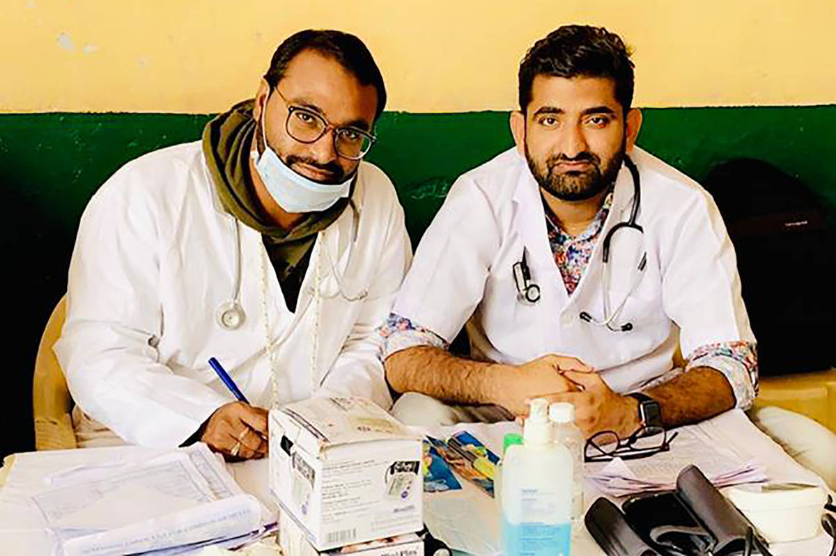 In this October 2019 photo provided by Bharat Sangwan, Joginder Chaudhary, left, and his friend ...