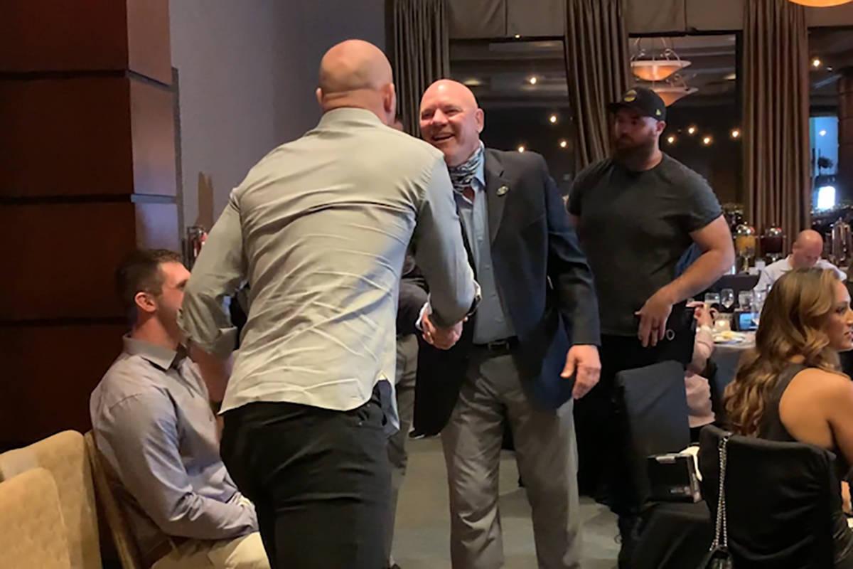 Jason Witten is seen shaking hands with Jay Schroeder, both maskless, at Darren Waller's founda ...