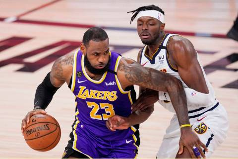 Los Angeles Lakers' LeBron James (23) drives against Denver Nuggets' Jerami Grant during the se ...