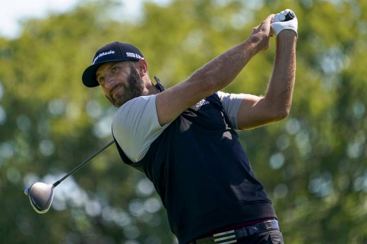 Dustin Johnson, of the United States, plays his shot from the fourth tee during the third round ...