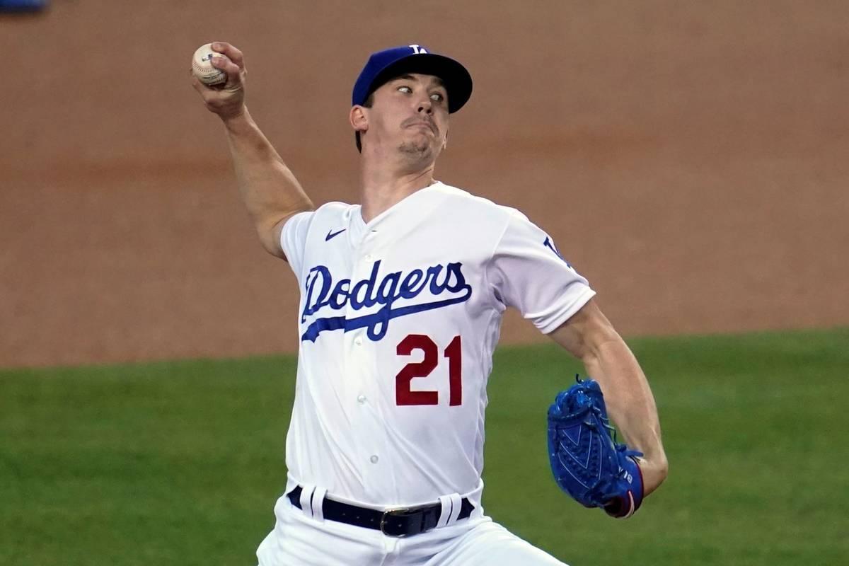 Los Angeles Dodgers starter Walker Buehler throws to an Oakland Athletics batter during the fir ...