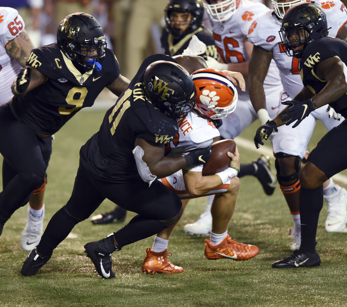 Wake Forest defensive lineman Miles Fox sacks Clemson quarterback Trevor Lawrence in the first ...