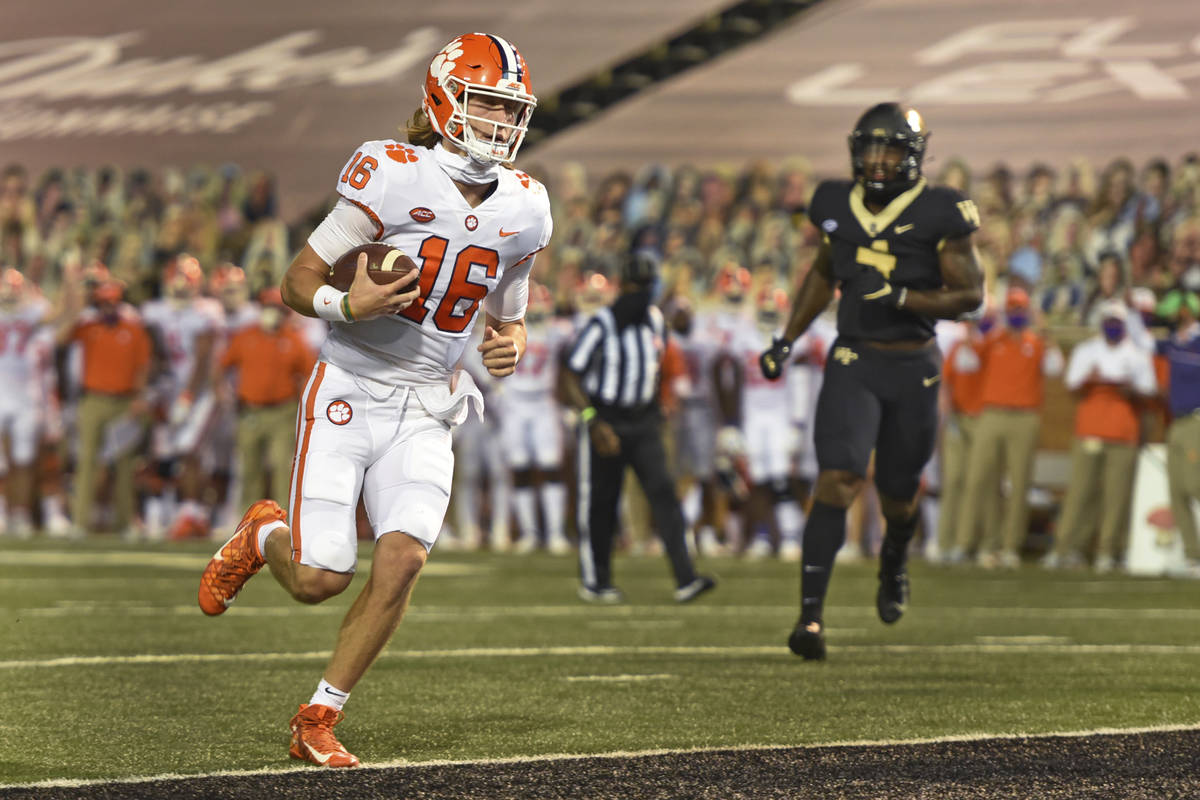 Clemson quarterback Trevor Lawrence scores against Wake Forest during the first half of an NCAA ...