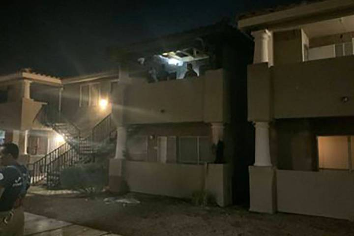 Two people were treated for smoke inhalation after a fire on a second-story balcony of an apart ...