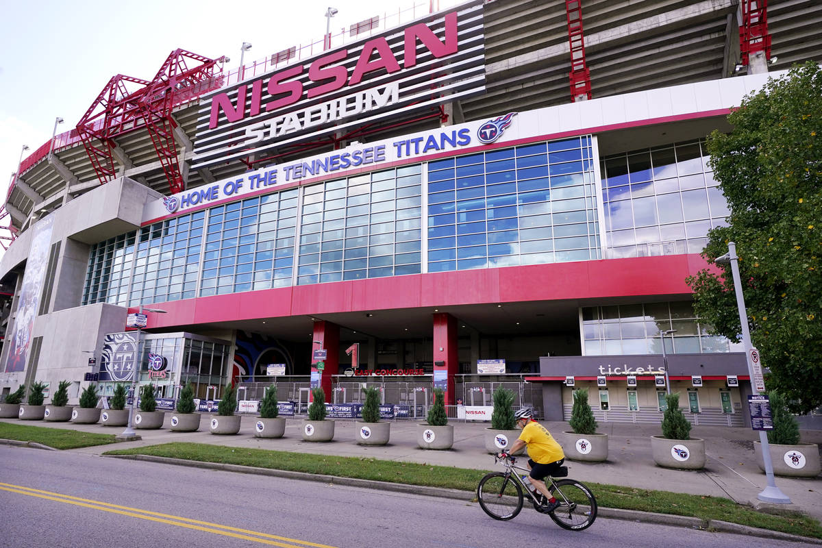 A cyclist passes by Nissan Stadium, home of the Tennessee Titans, Tuesday, Sept. 29, 2020, in N ...