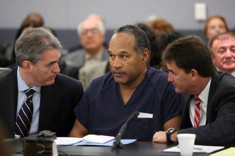 O.J. Simpson appears in court with attorneys Gabriel Grasso, left, and Yale Galanter prior to h ...