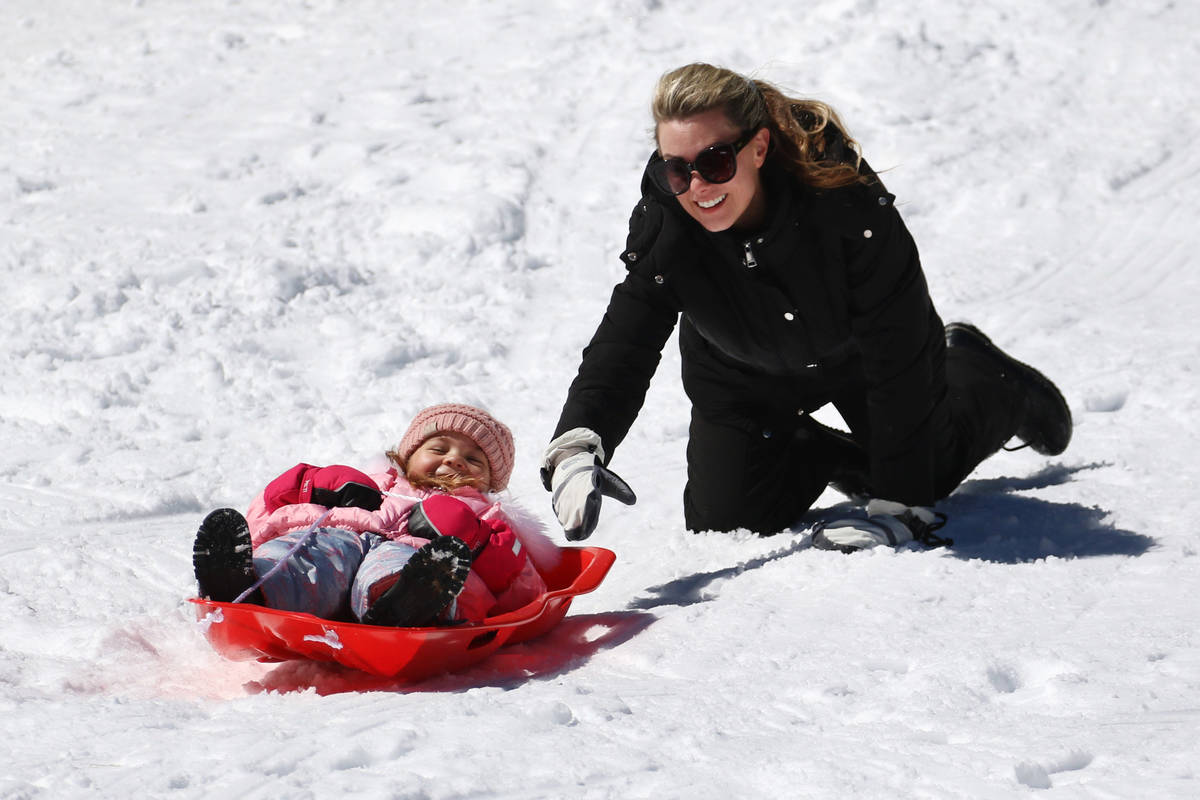 Blake Myers, 4, gets help from her mother, Jodi, as she sleds down a hill at Lee Canyon on Tues ...