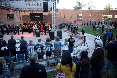 People stand for the honor guard at the Clark County Government Center amphitheater in Las Vega ...