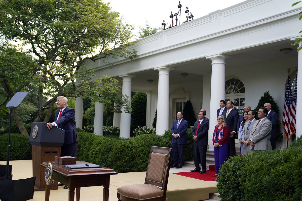 "President Donald Trump speaks before signing an executive order on the ""White House Hispan ..."