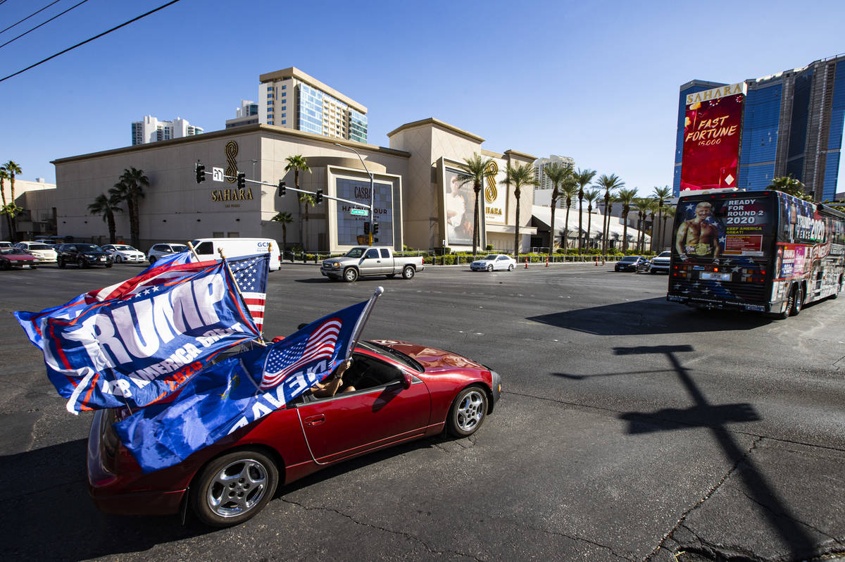 Helen McDonald, of Las Vegas, drives her car at the start of a parade in support of law enforce ...