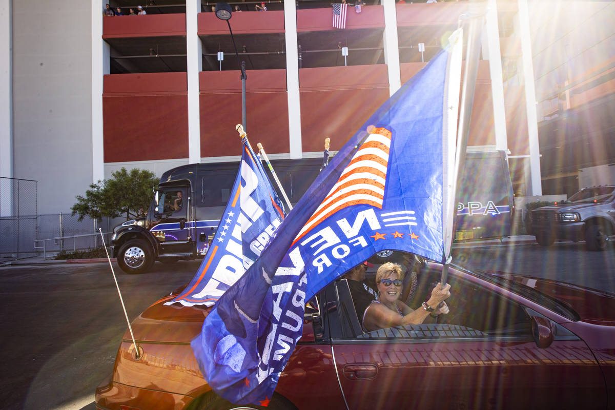 Lisa Schultz, of Las Vegas, waves a flag as supporters of law enforcement and President Donald ...