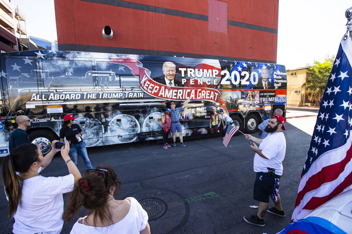 People take photos as supporters of law enforcement and President Donald Trump prepare for a pa ...