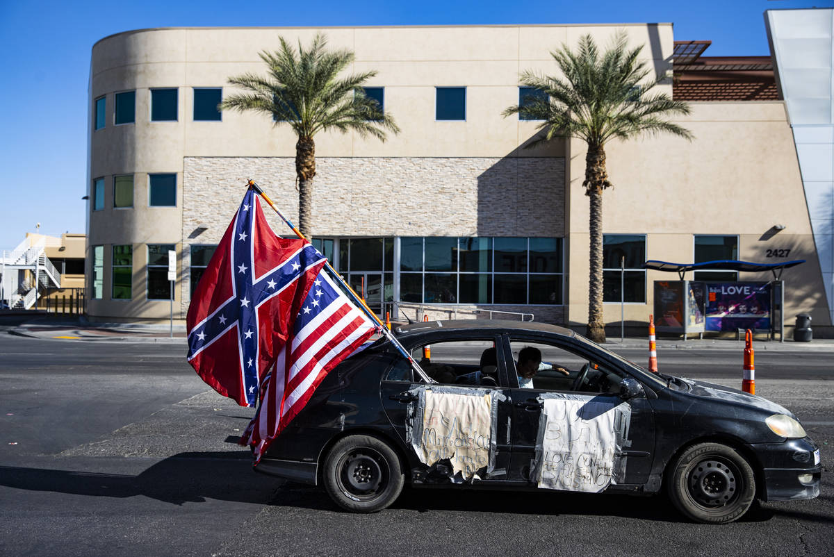 People participate in a parade in support of law enforcement and President Donald Trump in Las ...