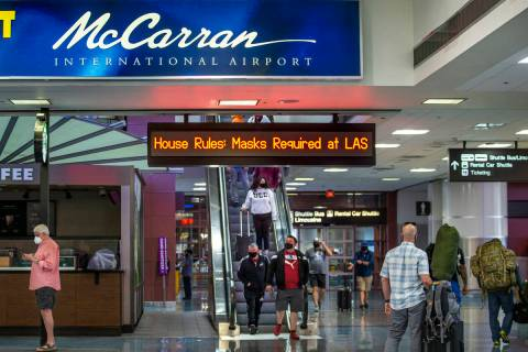 Passengers move about the Terminal 1 baggage claim area at McCarran International Airport on W ...