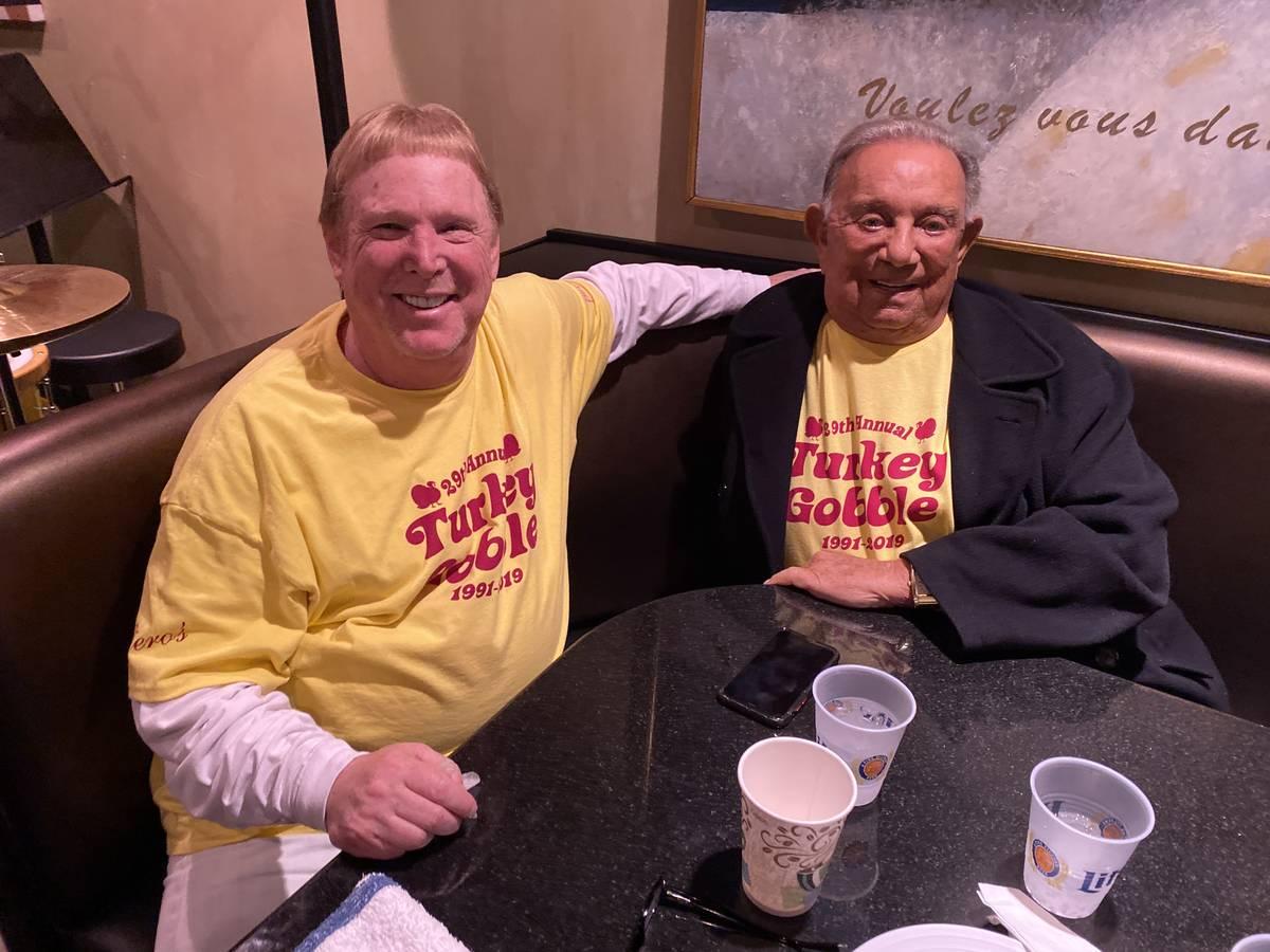 Raiders owner Mark Davis, left, with Piero's Italian Restaurant owner Freddie Glusman, during a ...