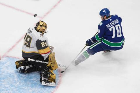 Vegas Golden Knights goalie Marc-Andre Fleury (29) makes a save on Vancouver Canucks' Tanner Pe ...