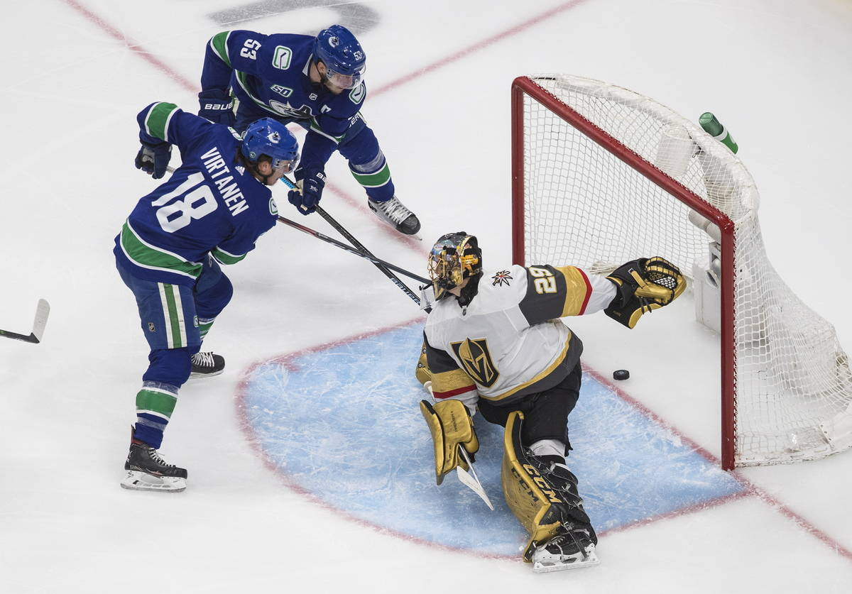 Vegas Golden Knights goalie Marc-Andre Fleury (29) is scored on by Vancouver Canucks' Bo Horvat ...