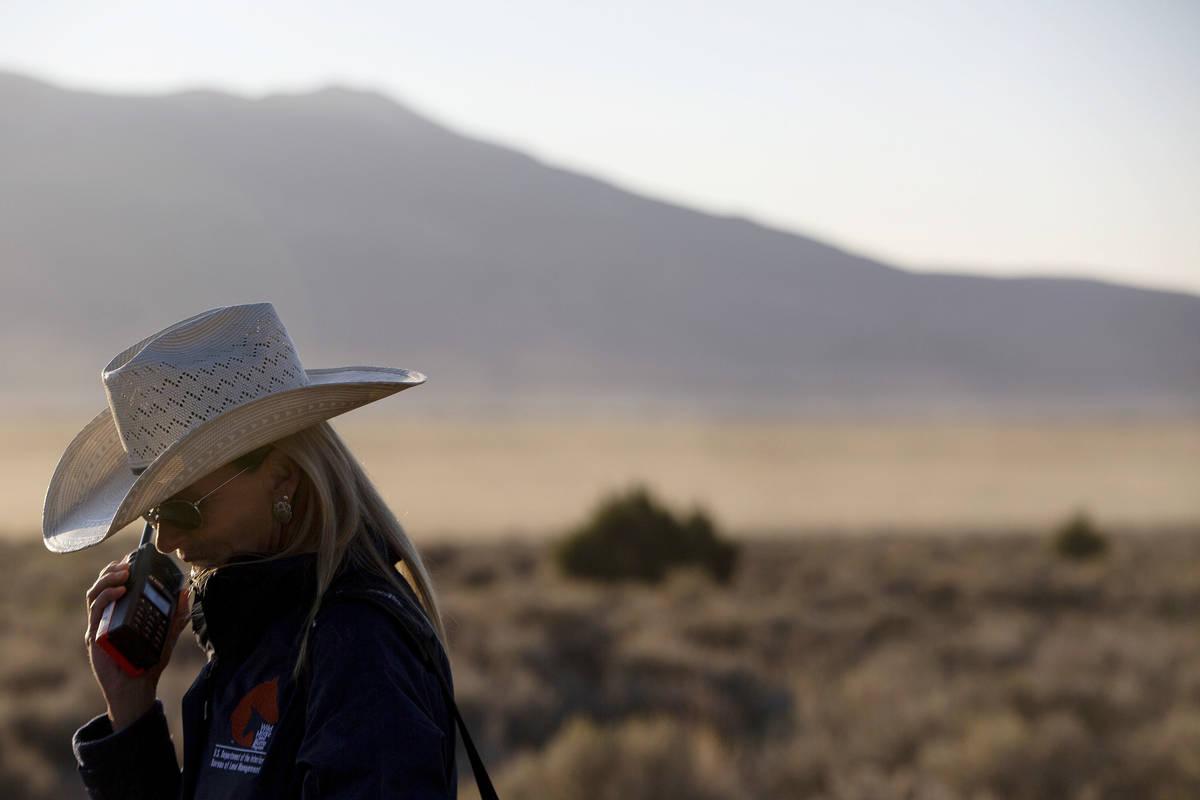 U.S. Bureau of Land Management spokeswoman Jenny Lesieutre speaks with incident command via rad ...