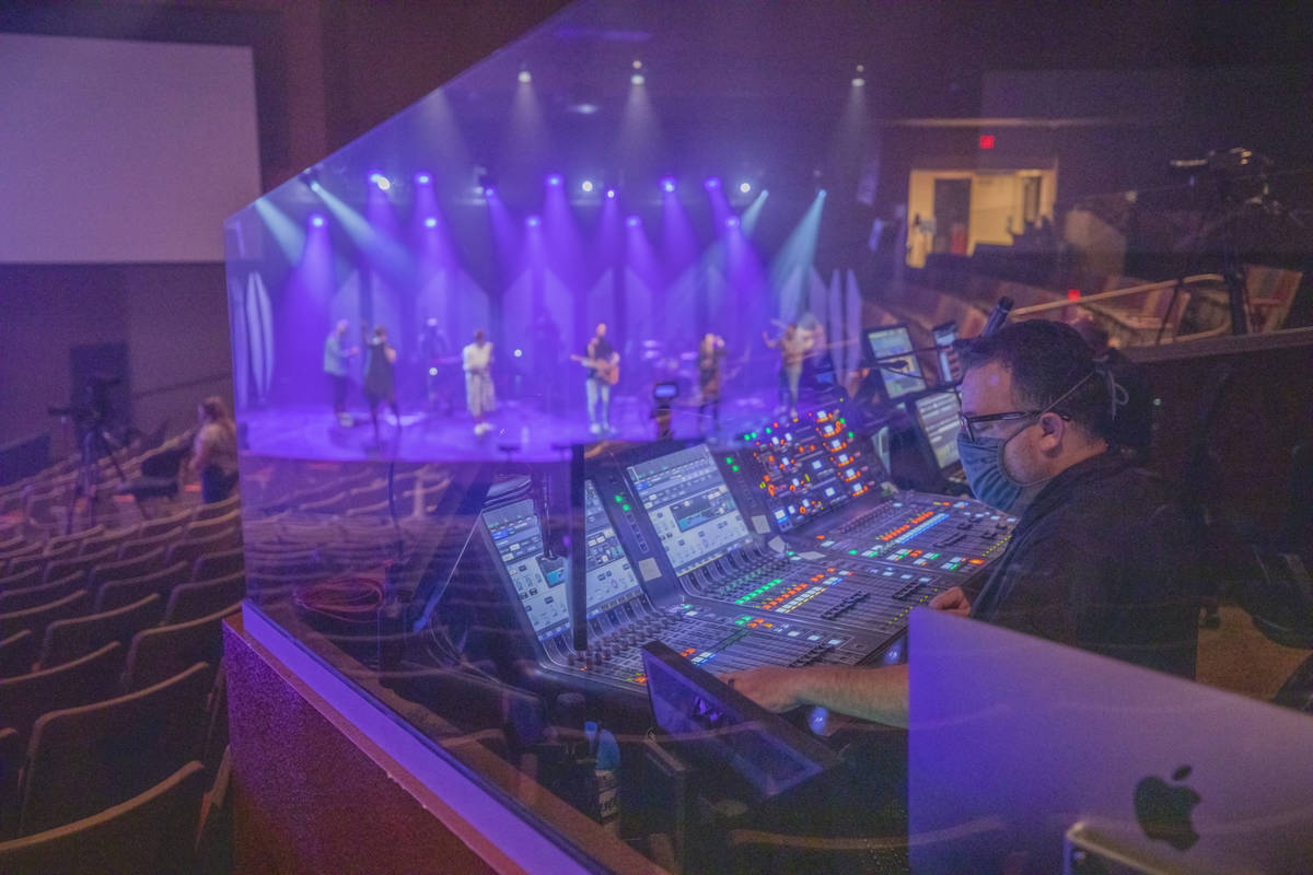 Production director Billy Baker oversees as Canyon Ridge Christian Church's worship team practi ...