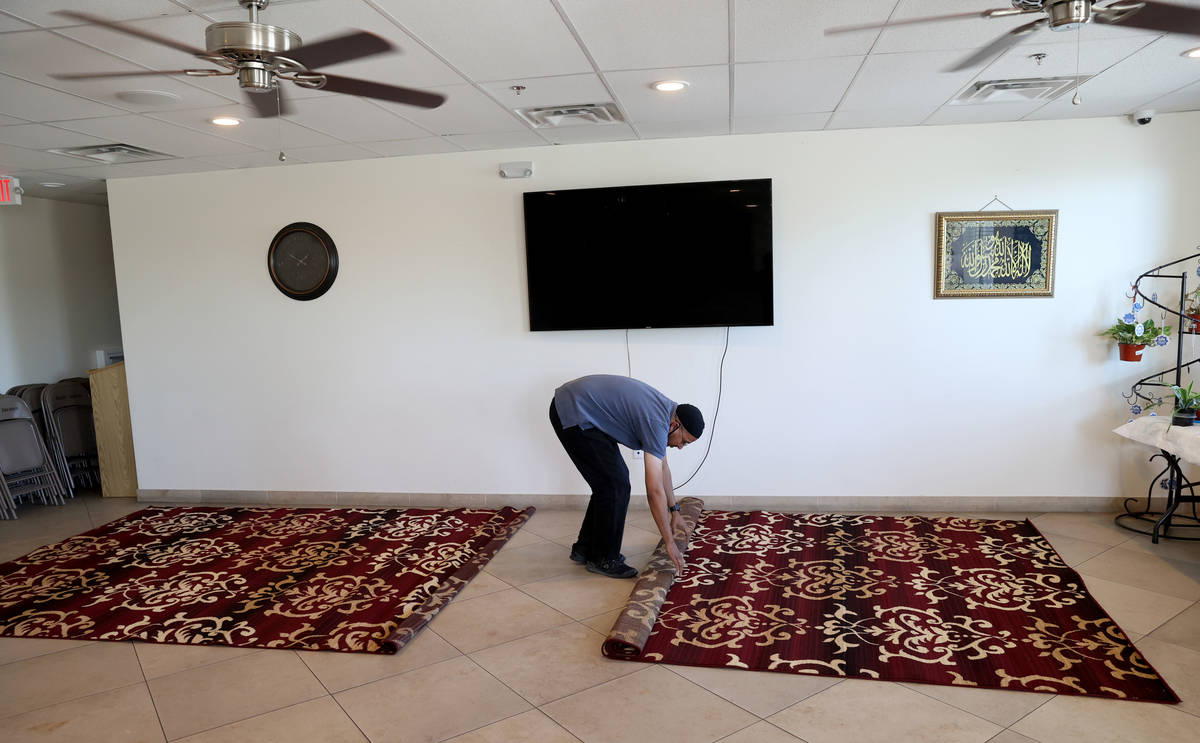 Shamsuddin Waheed, imam at Masjid Ibrahim in Las Vegas, places carpet in his social hall Thursd ...